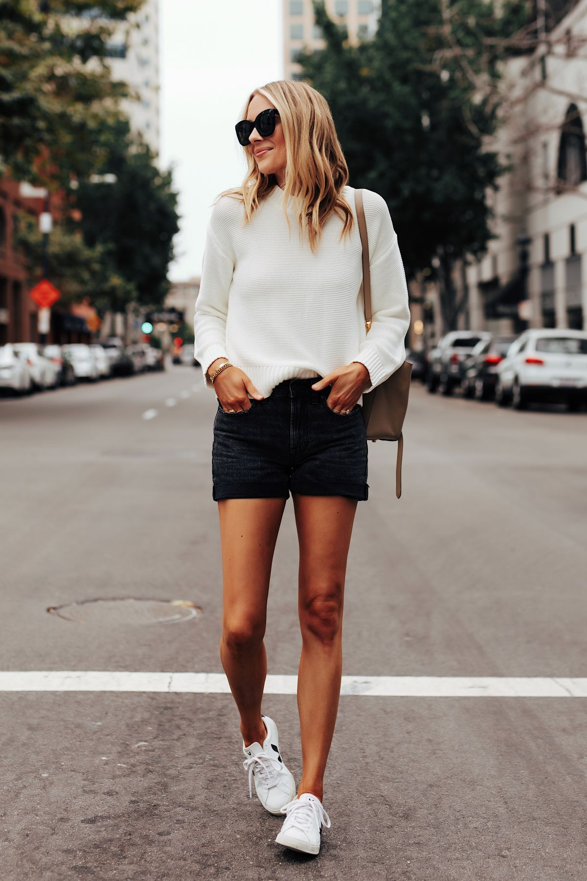 Fashion Jackson Wearing Everlane White Crewneck Sweater Everlane Black Denim Shorts Veja Esplar Sneakers
