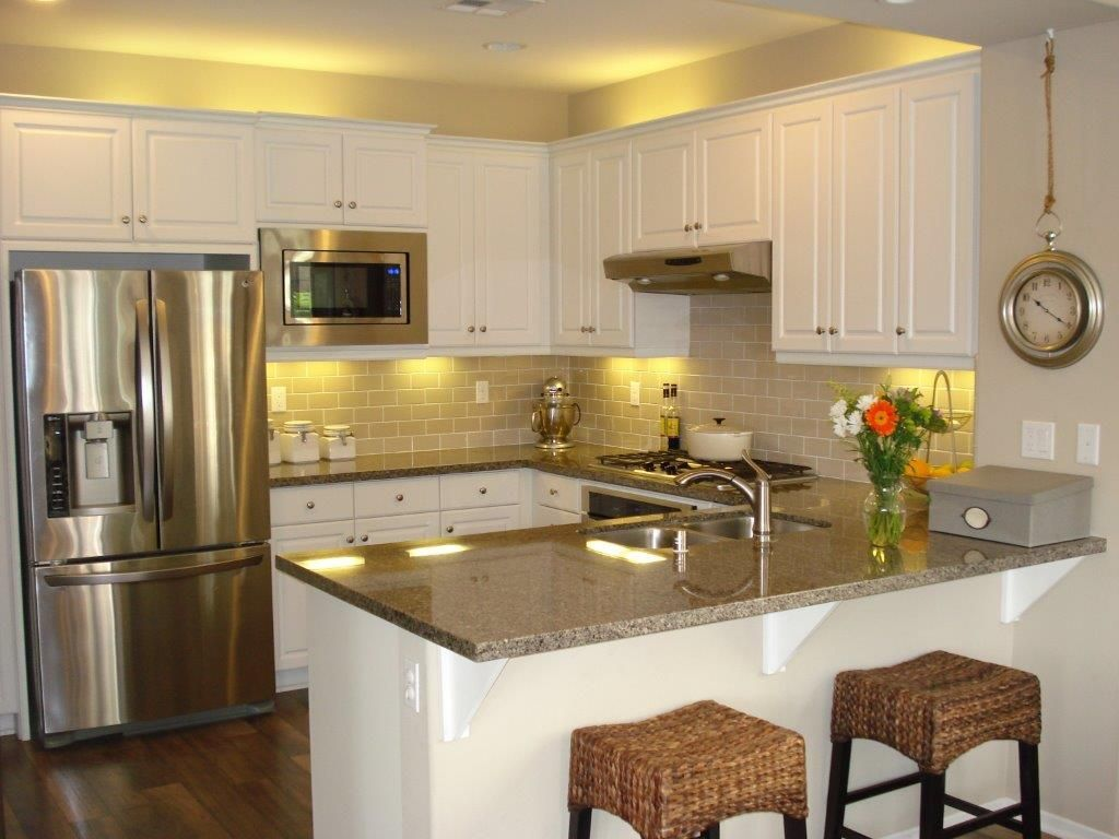 traditional kitchen with hardwood floors flush simple granite counters high ceiling on c kitchen id=20899
