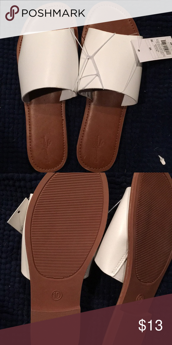 1c1d70629 🎁🎁White slide sandals. Simple leather bottom. White top. NWT.   Bundle  and save! Bundle any 3 items with the 🎁🎁symbol for  25 and  4.99 shipping.