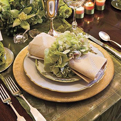 Try Using Runners  Instead of using a tablecloth, arrange sheer runners across the width of the table. Purchase inexpensive gold glass chargers from an imports store. Change your tableware with the season but use the chargers throughout the year.