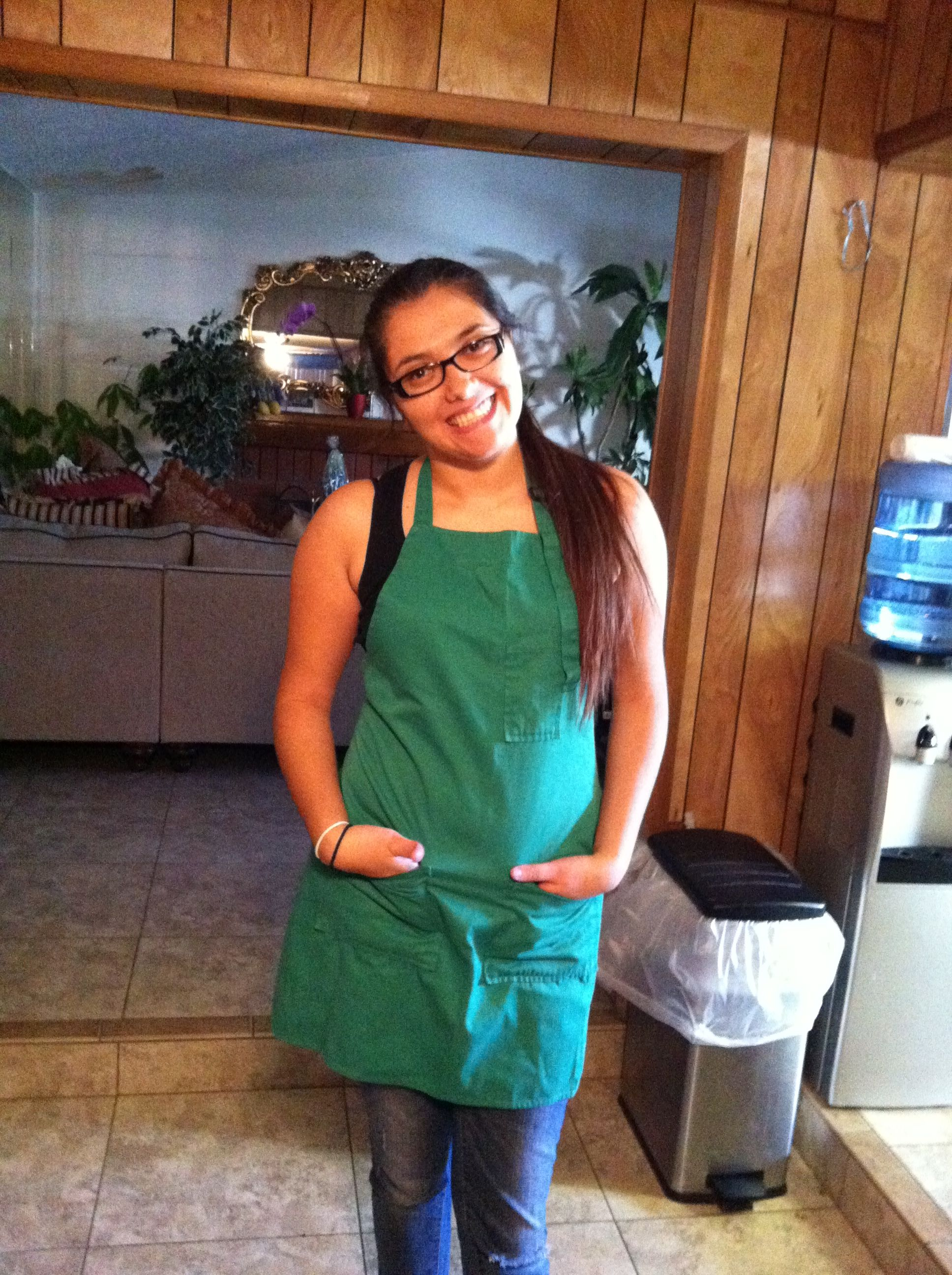 Me with my apron on ready to cook I am going to be the next great baker