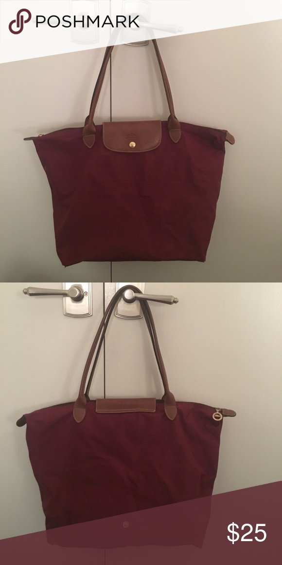 Longchamp Medium Le Pliage Bag in Burgundy Medium Longchamp Le Pliage bag  in Burgundy. Used for a couple of years. Longchamp Bags Totes d2e055203a
