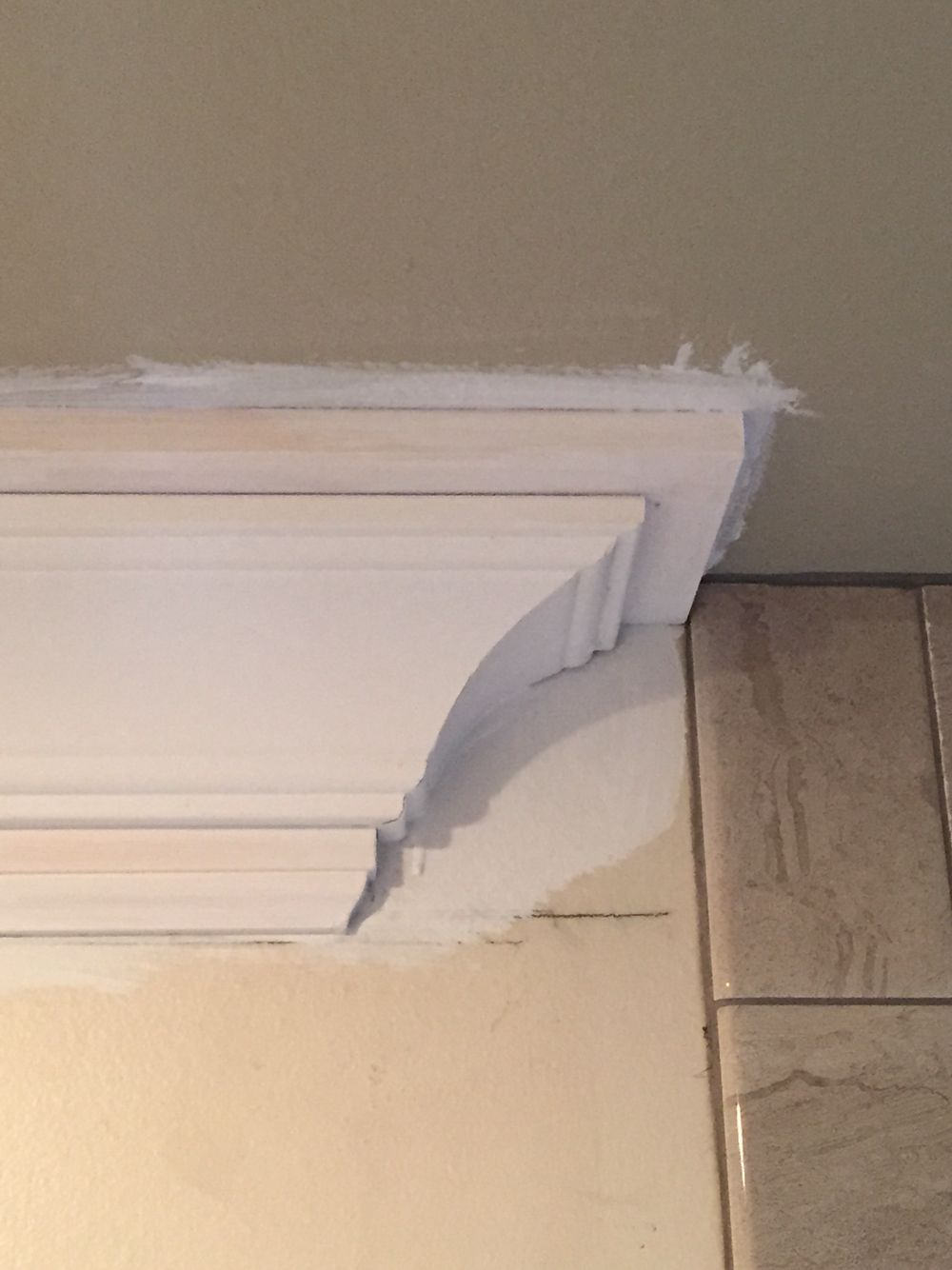 Craftsman Style Crown Molding Termination Return Before Caulking And Painting At Shower Tile