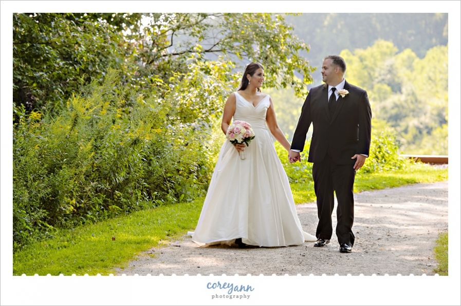 Bride And Groom Wedding Portrait Walking Down Path Near Indigo Lake At Cuyahoga Valley National Park In Akron Ohio Wedding Wedding Portraits Wedding Photoshoot