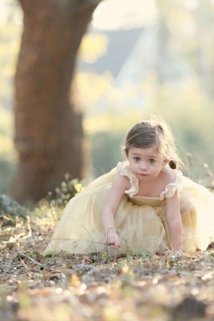Little one in butter yellow dress