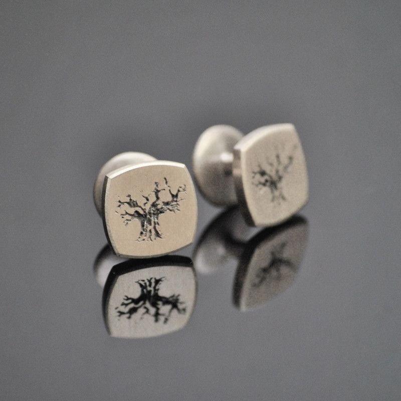 Baobab Tree Cufflinks.  A solid sterling silver set of cufflinks featuring an image of the iconic Baobab tree.  The tree is engraved onto the silver cufflink with a black oxidised finish.