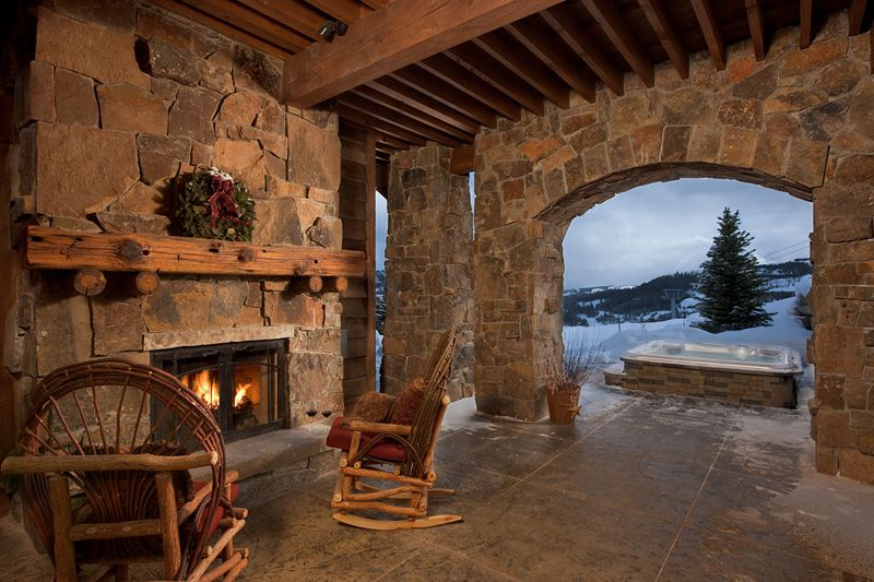 Locati architects covered patio with fireplace from for Walkout basement patio ideas