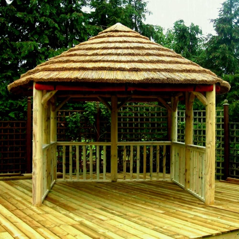 Diy Rustic Bamboo Gazebo Canopy With Vertical Fence And Curve Pile Straw Roof Avec Images Gazebo Design Dog Fence