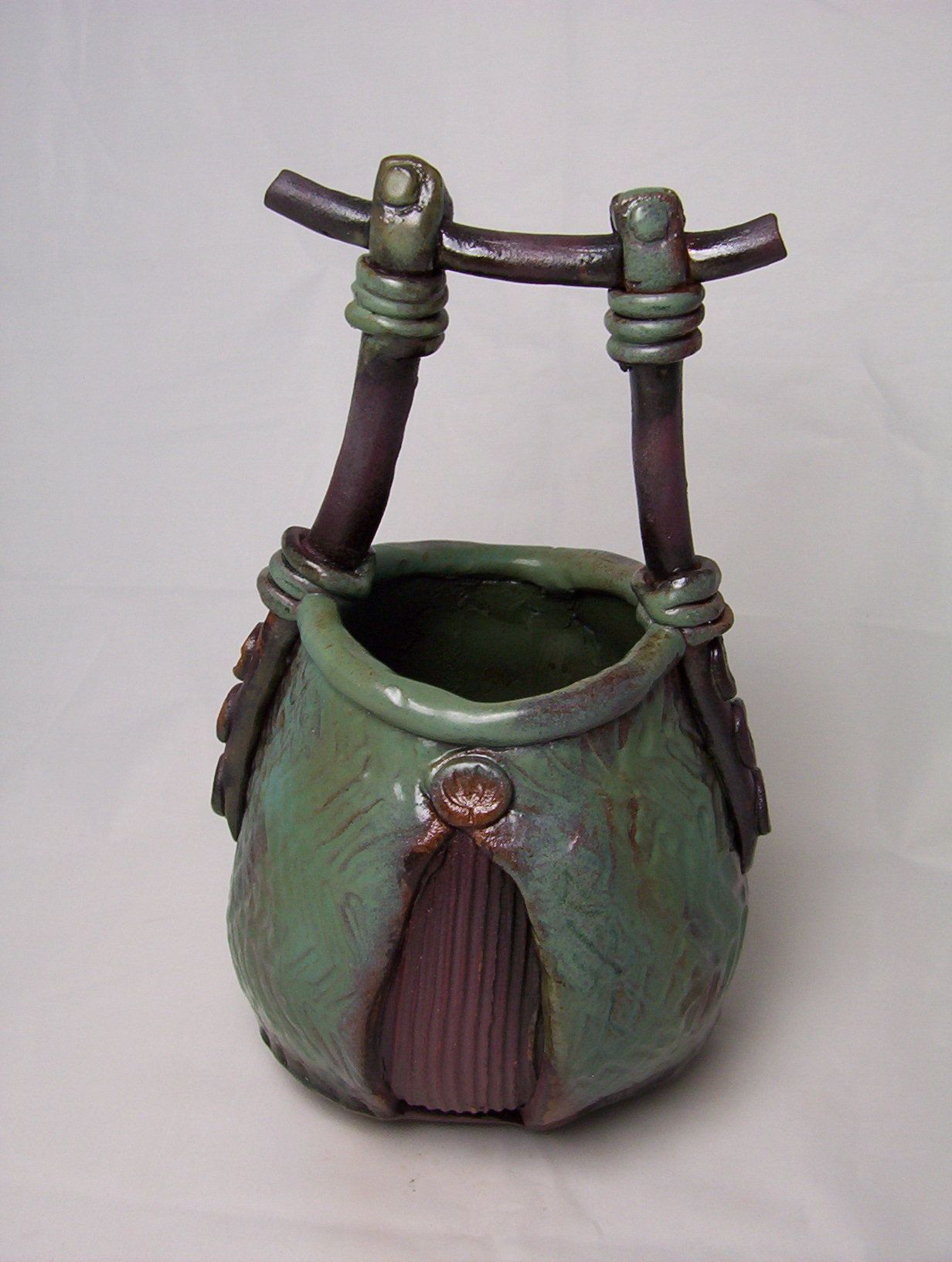 POTTERY: Asian styled basket; 2 glazes and iron oxide wash
