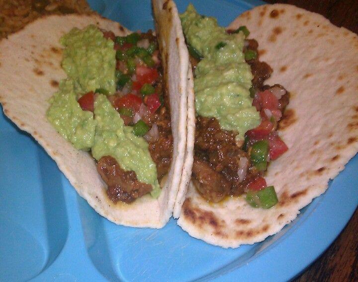 Delicious Pork Carnitas with homemade guacamole and pico de gallo....yummmm