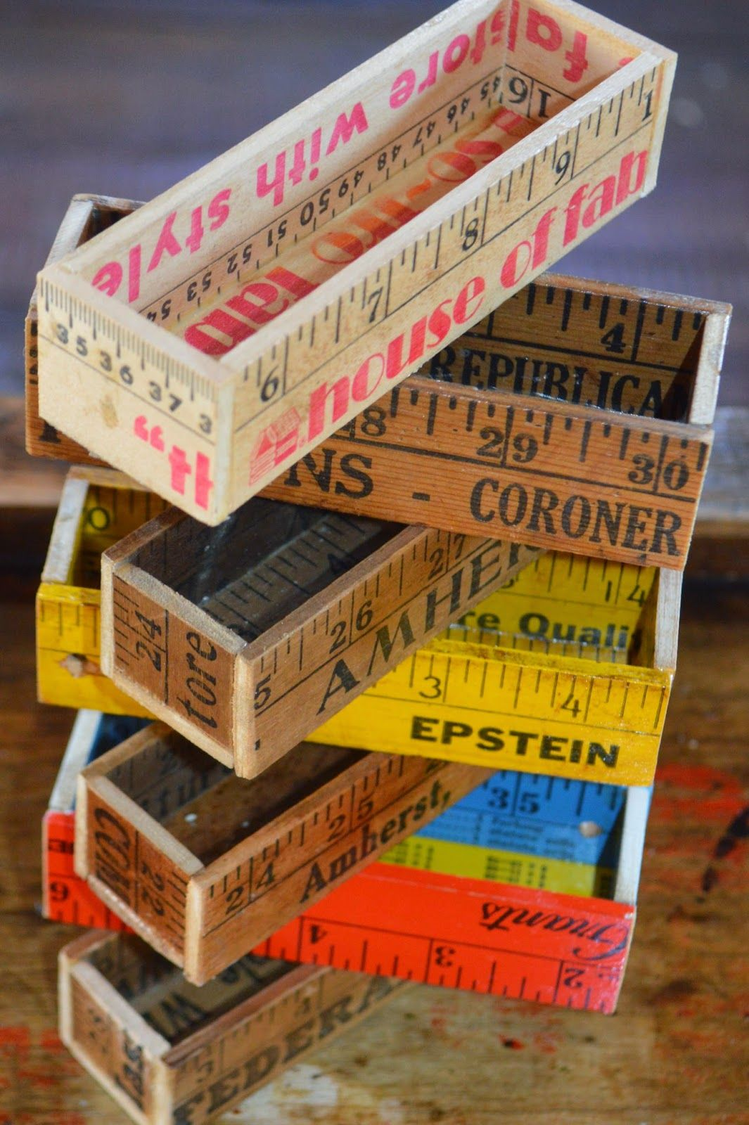 These yard sticks turned business card holders are a