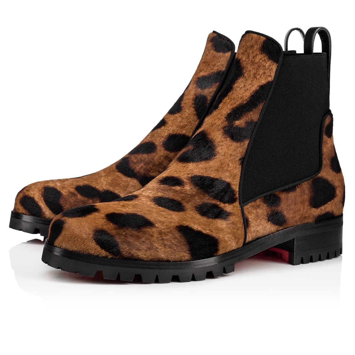 a6e334df0a30 A modern style, the Marchacroche boot seduces with its casual elegance.  Made of maxi leo-printed pony hair, it is mounted on a lug sole.