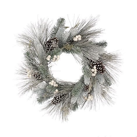 Ideal for adding a wintery touch to the home, this traditional wreath is finished in a frosted hue and adorned with pine cones and berries   the perfect dose of festive charm.