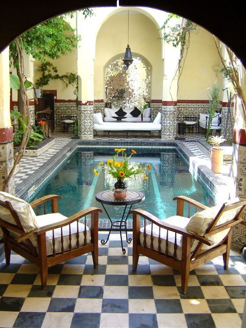 I love the interior courtyards of moroccan designs Homes with inner courtyards