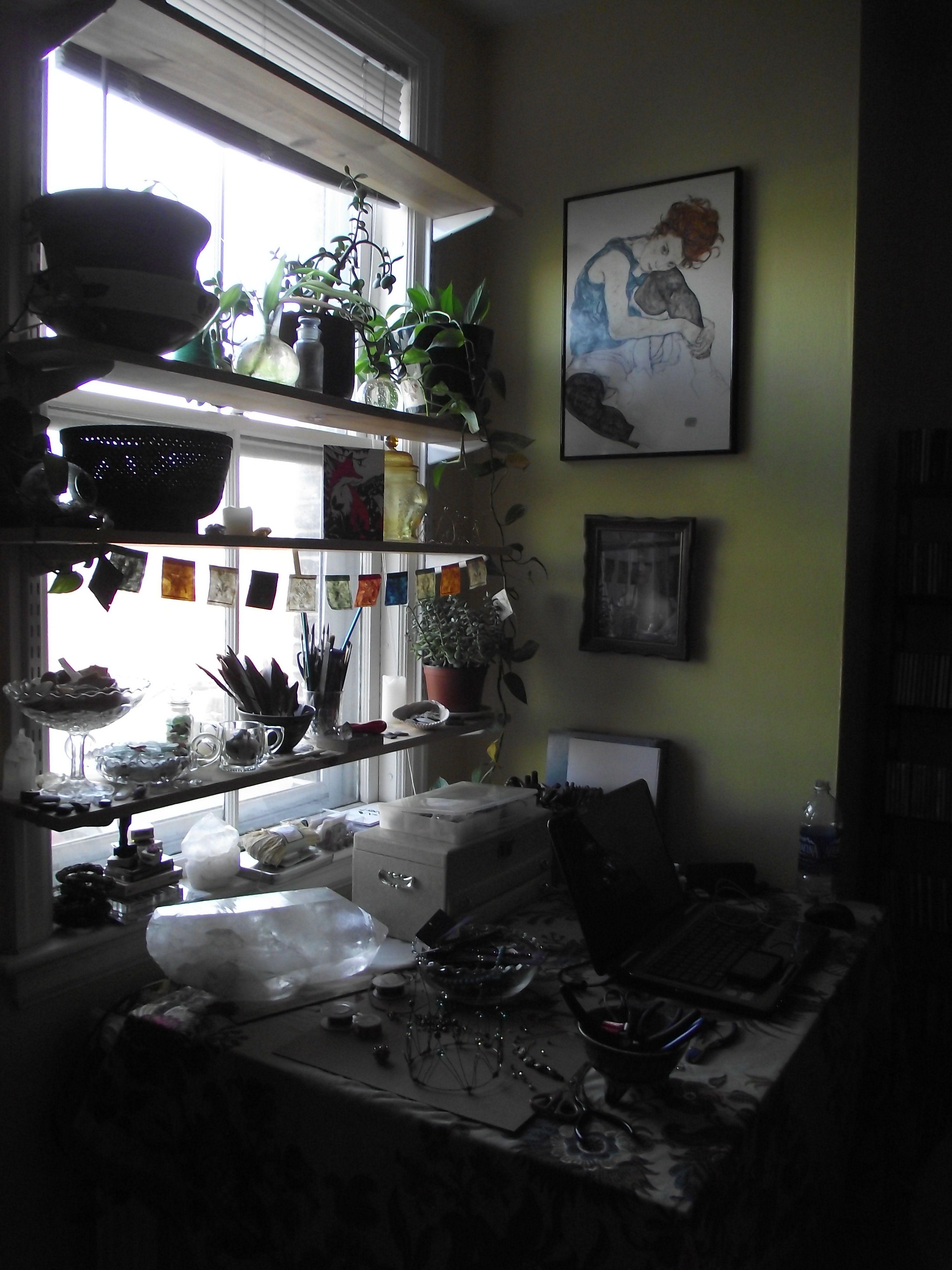 Shelf across kitchen window  blocks the light but you could do just one shelf across the window