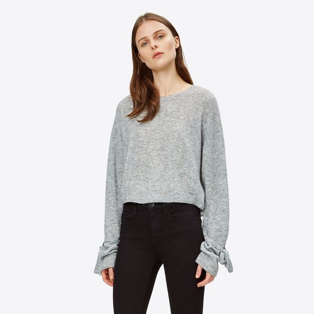Cropped sweater in Italian merino wool with wrist tie detailing.