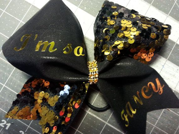 Check out this item in my Etsy shop https://www.etsy.com/listing/225319165/im-so-fancy-cheer-bow-w-bling-center-by