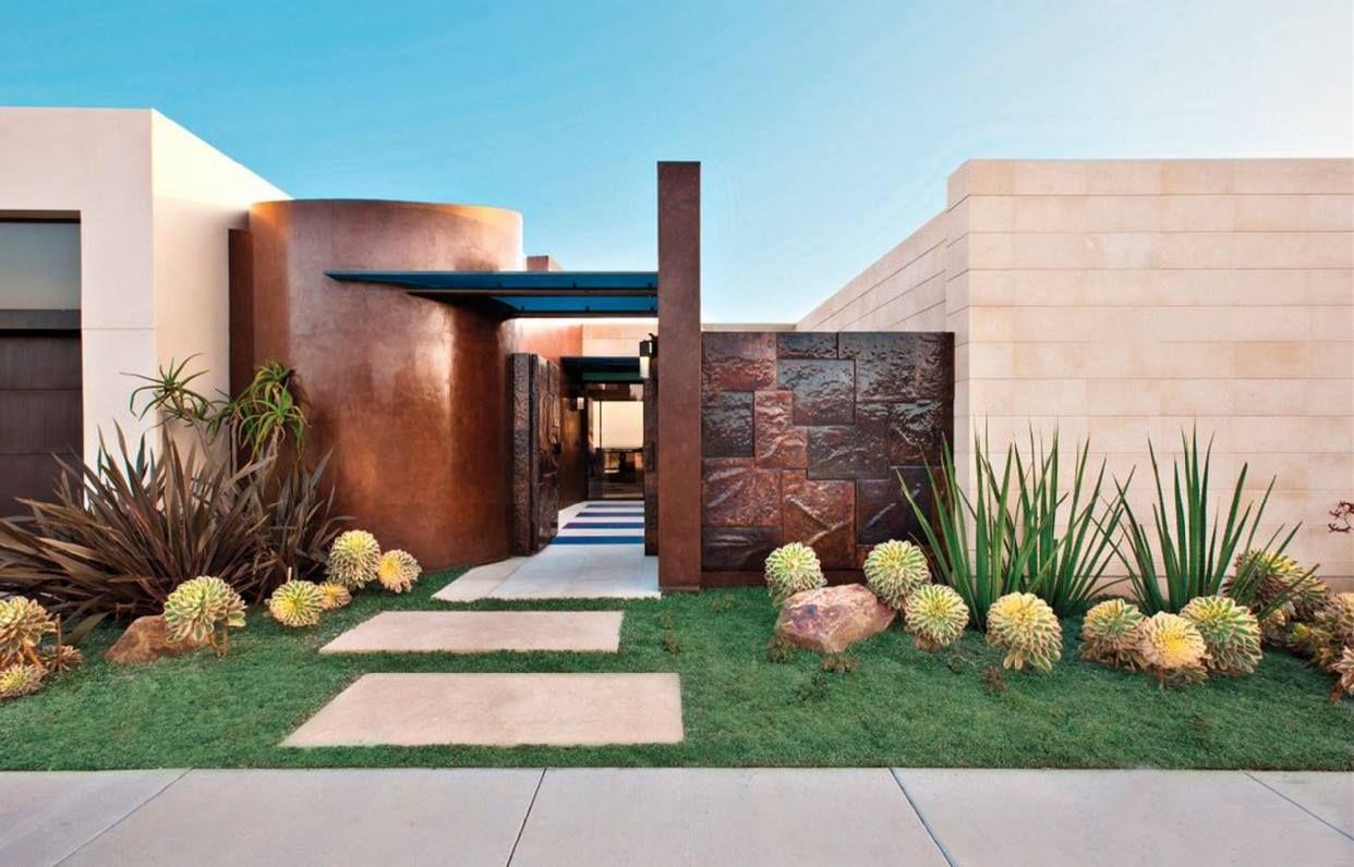 Giardino e ingresso di una casa moderna con vialetto a - Design giardino casa ...