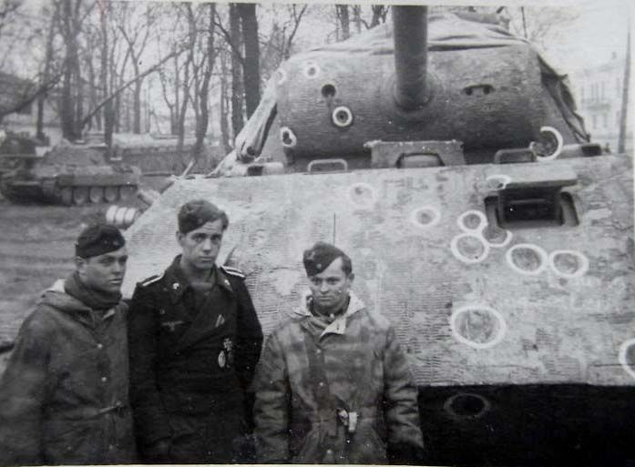 Panzerkampfwagen V Panther Ausf. D (Sd.Kfz 171) and crew.  This tank is riddled with shell impacts of all sizes and seems to be rather well!
