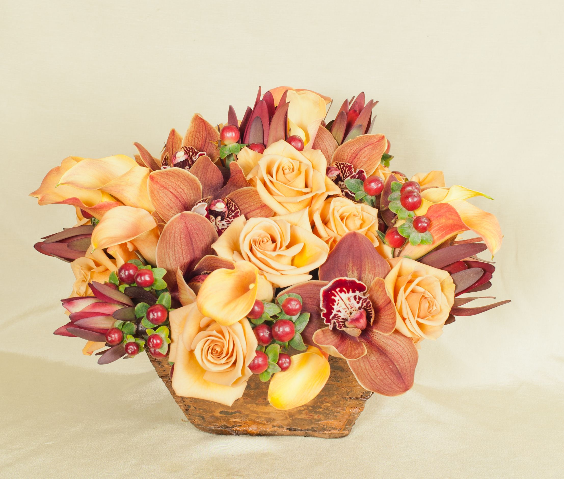 Autumn harvest flowers warm fall floral arrangement in chocolate