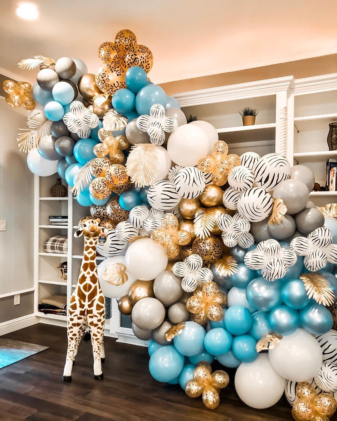 "Balloon Therapy on Instagram: ""A wild one is on the way! 🦒💙 Fun safari backdrop for a sweet baby shower!"""