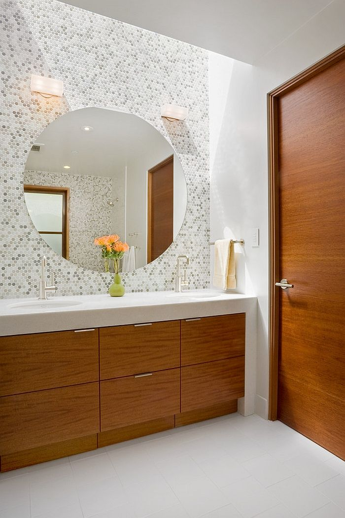 large round mirror above the bathroom vanity