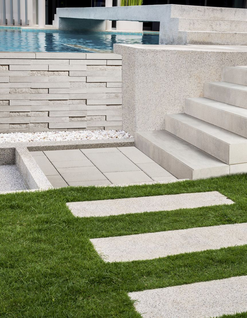 Modern looking walkway stone steps and wall using