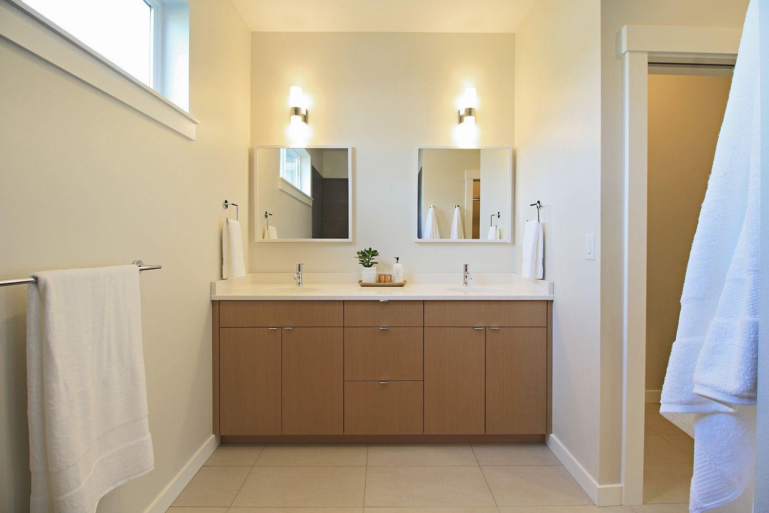 Master bath double vanity with silver elm flat panel for Master bathroom countertops