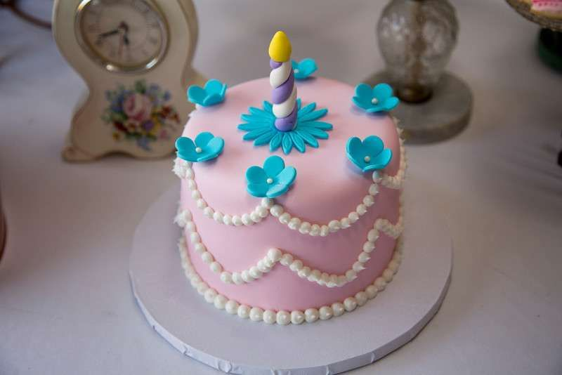 Cute pink cake at an Alice in Wonderland tea party birthday party! See more party planning ideas at CatchMyParty.com!