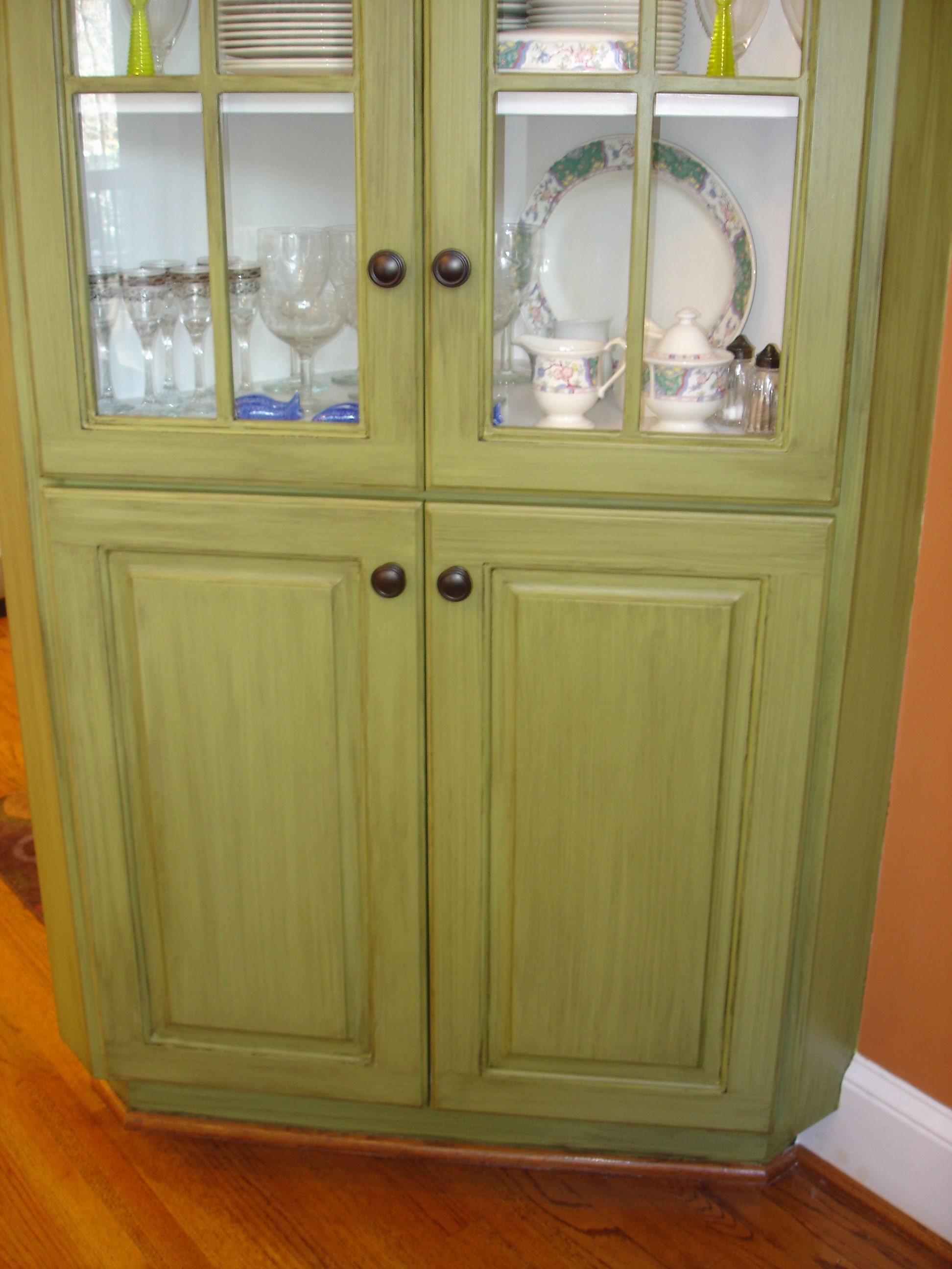 Corner china cabinet.. was solid white.. painted green & added brown/black glaze.. really cool! Did this for Jennie;)