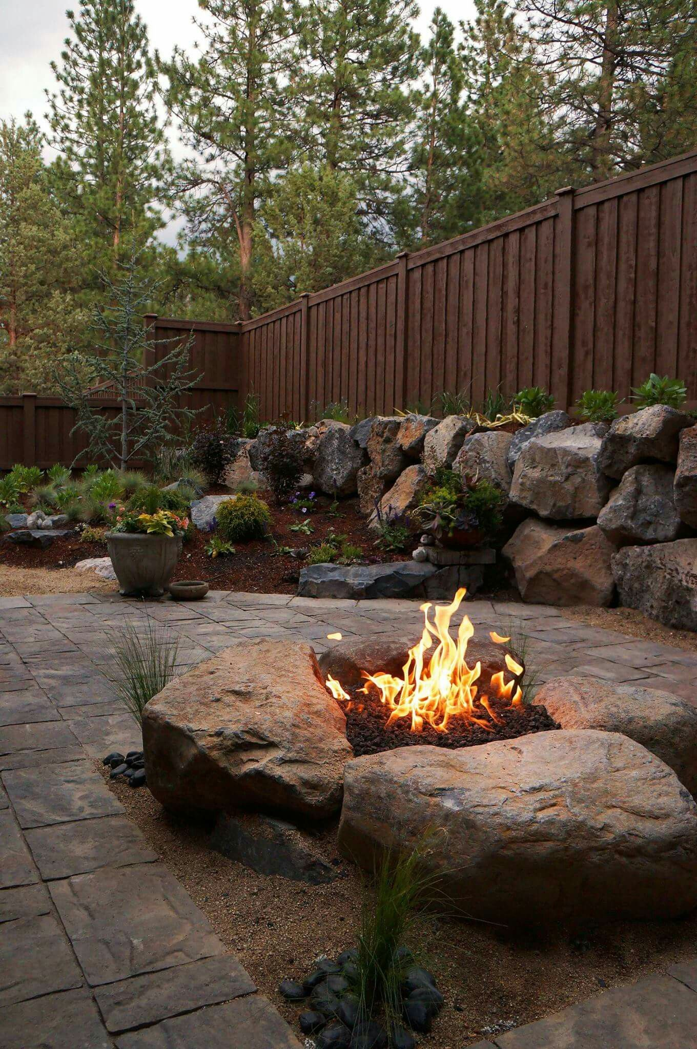 Boulder Fire Pit By Newport Landscaping In Bend, Or