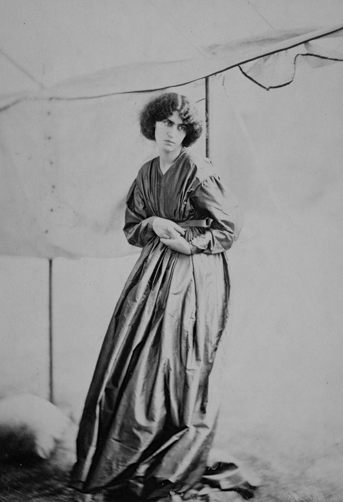 Jane Morris standing in a marquee, photographed by John R. Parsons in June 1865