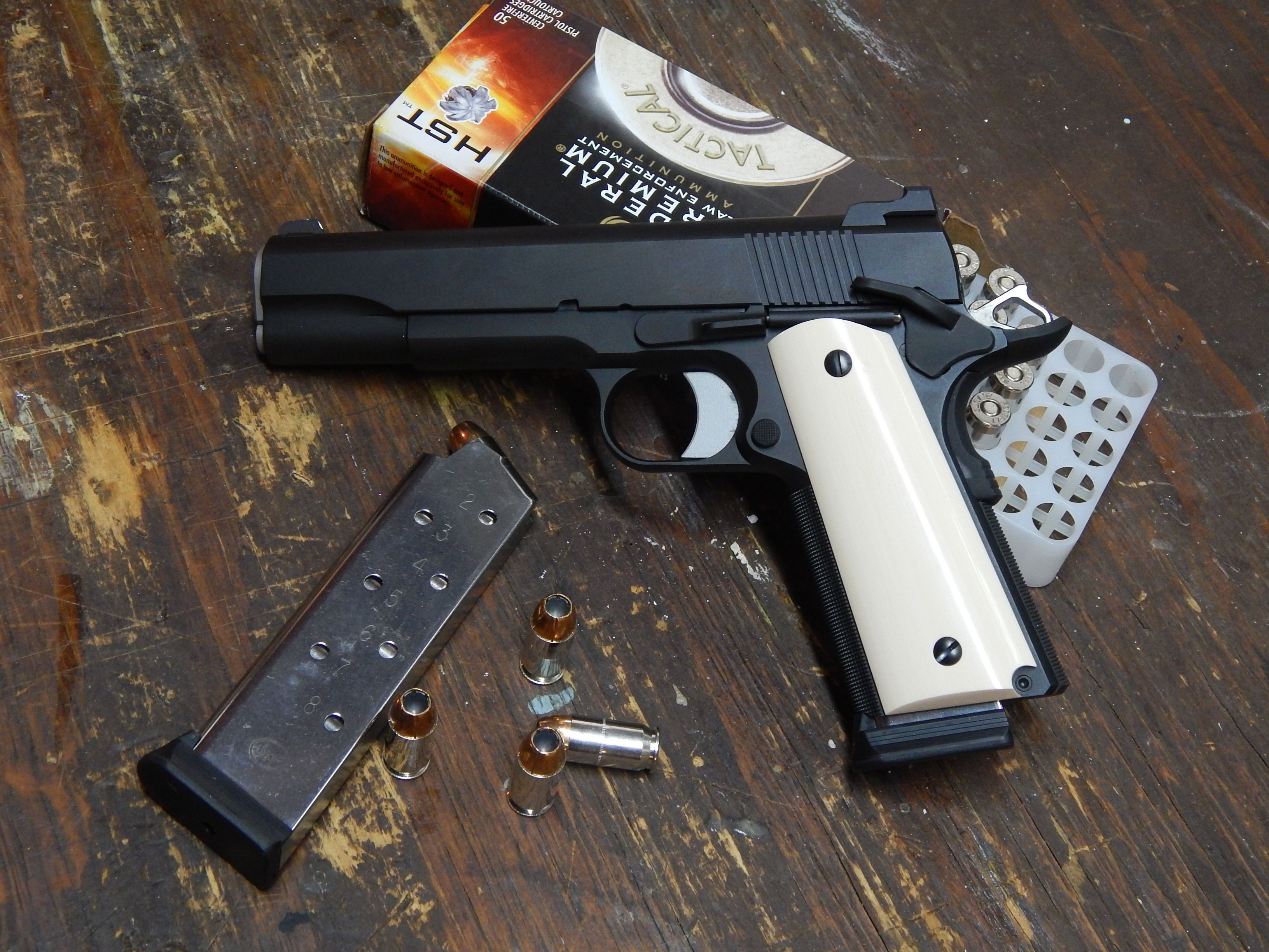 Dan Wesson Valor with Ivory Grips Loading that magazine is a pain! Get your Magazine speedloader today! http://www.amazon.com/shops/raeind
