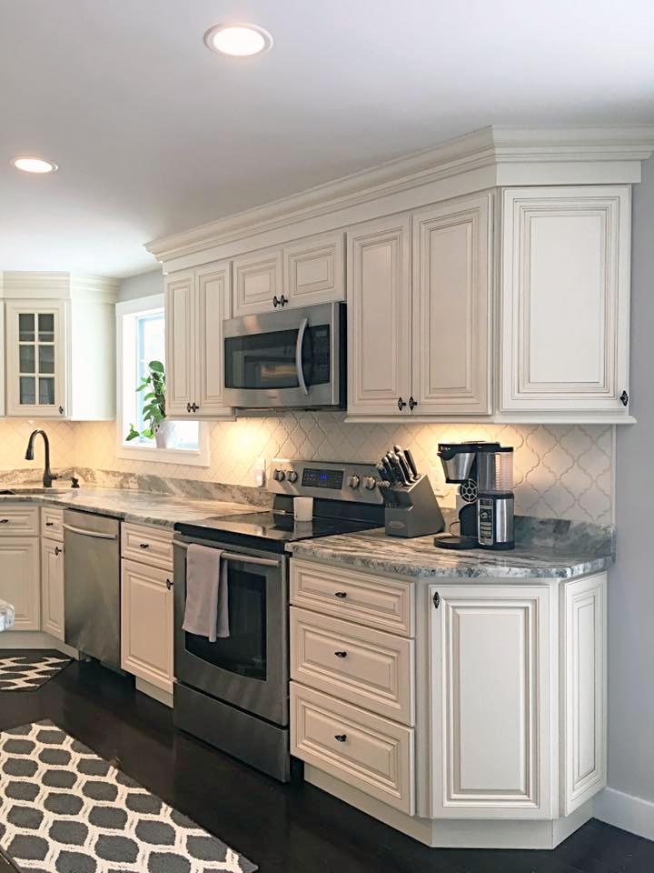 Jsi Cabinetry S Wheaton Cabinets With Fantasy Brown Granite Countertop White Kitchen Cabinets Kitchen Backsplash Fantasy Brown Granite