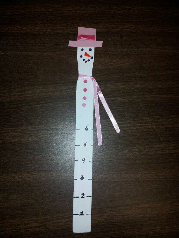 Paint stick snowman snow gauge. All you need is *paint stick(paint white) *old cards (for hat and buttons) *ribbon(for scarf) *permanent markers (for measurement and face)