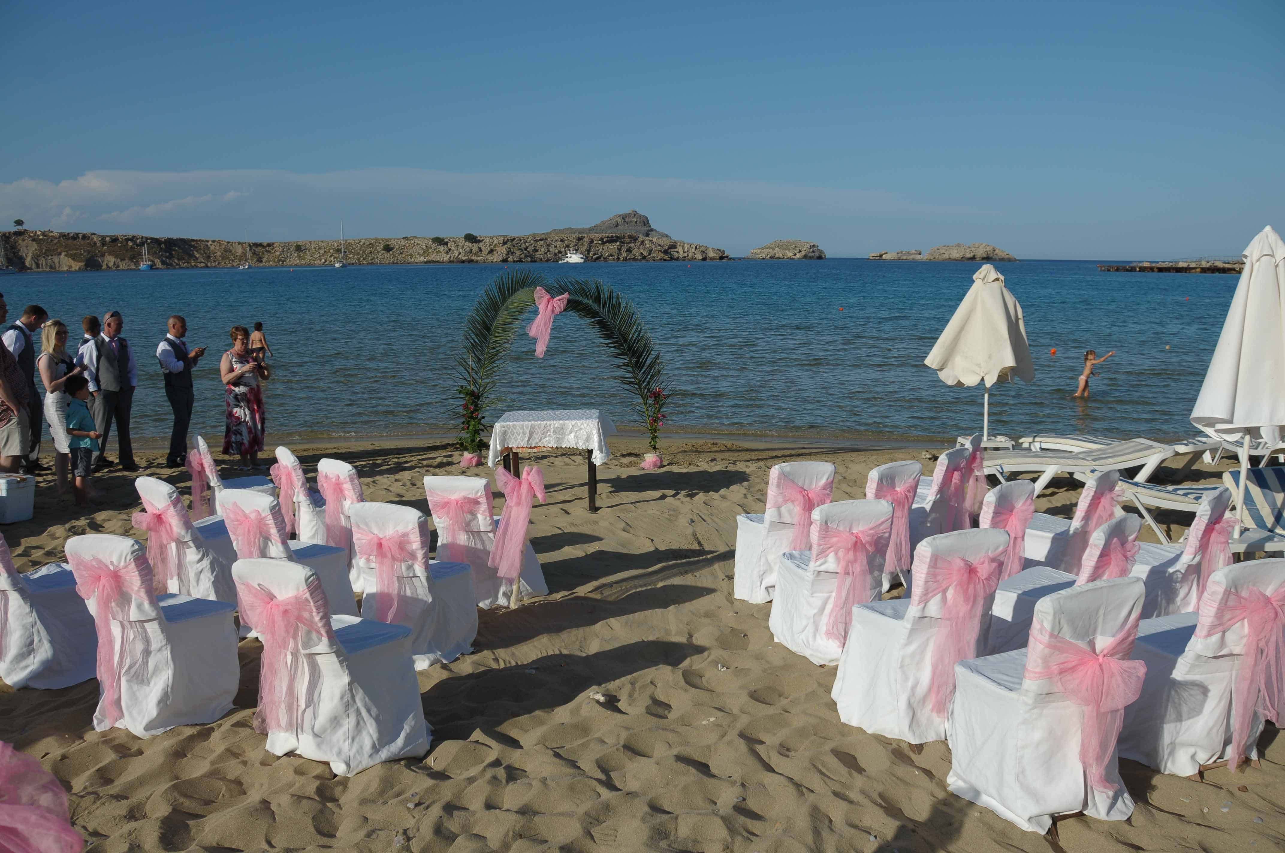 Lindos beach wedding in front of dolphin taverna hotel