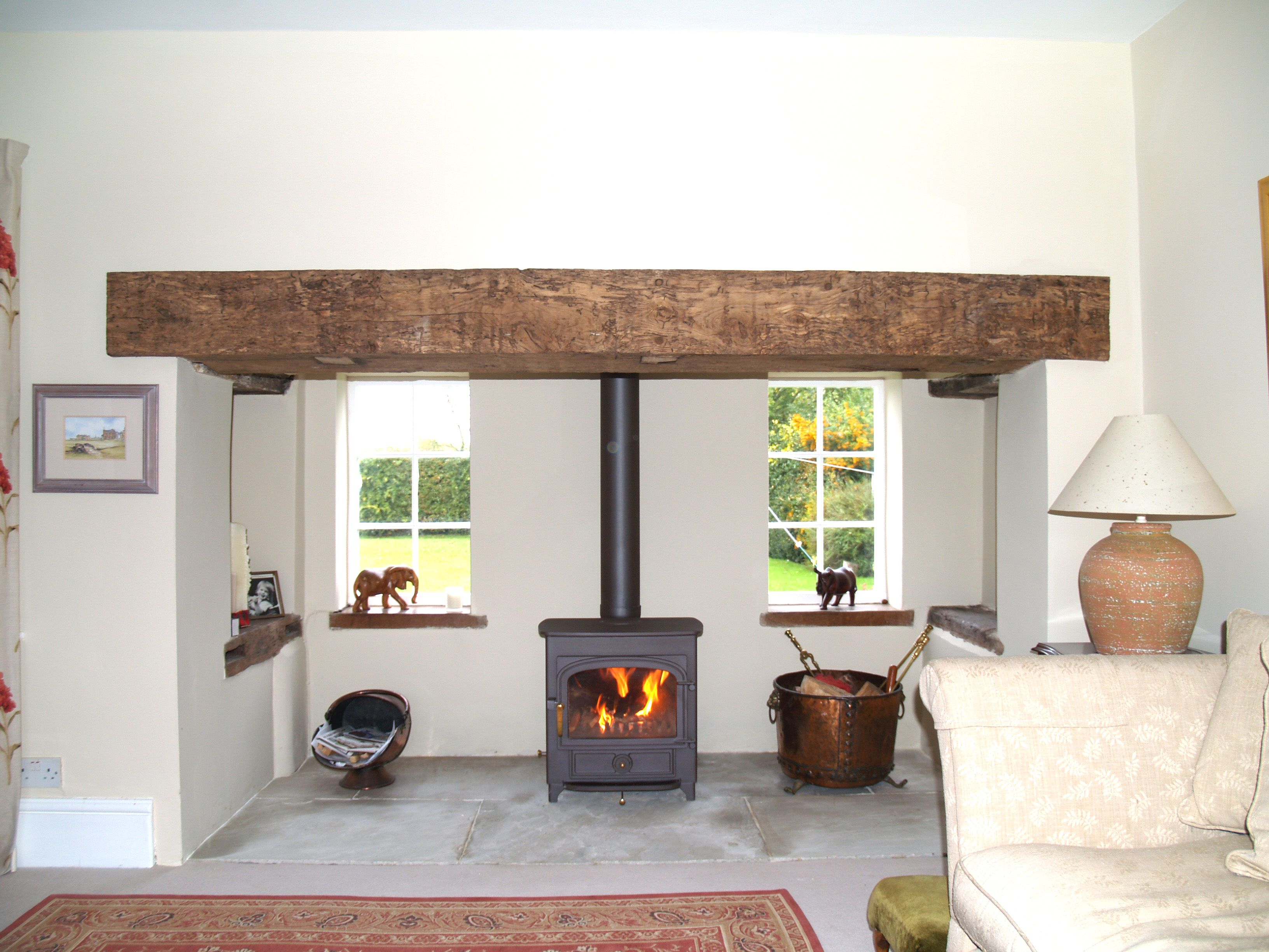 renovated essex inglenook with clad reclaimed oak beam sand stone