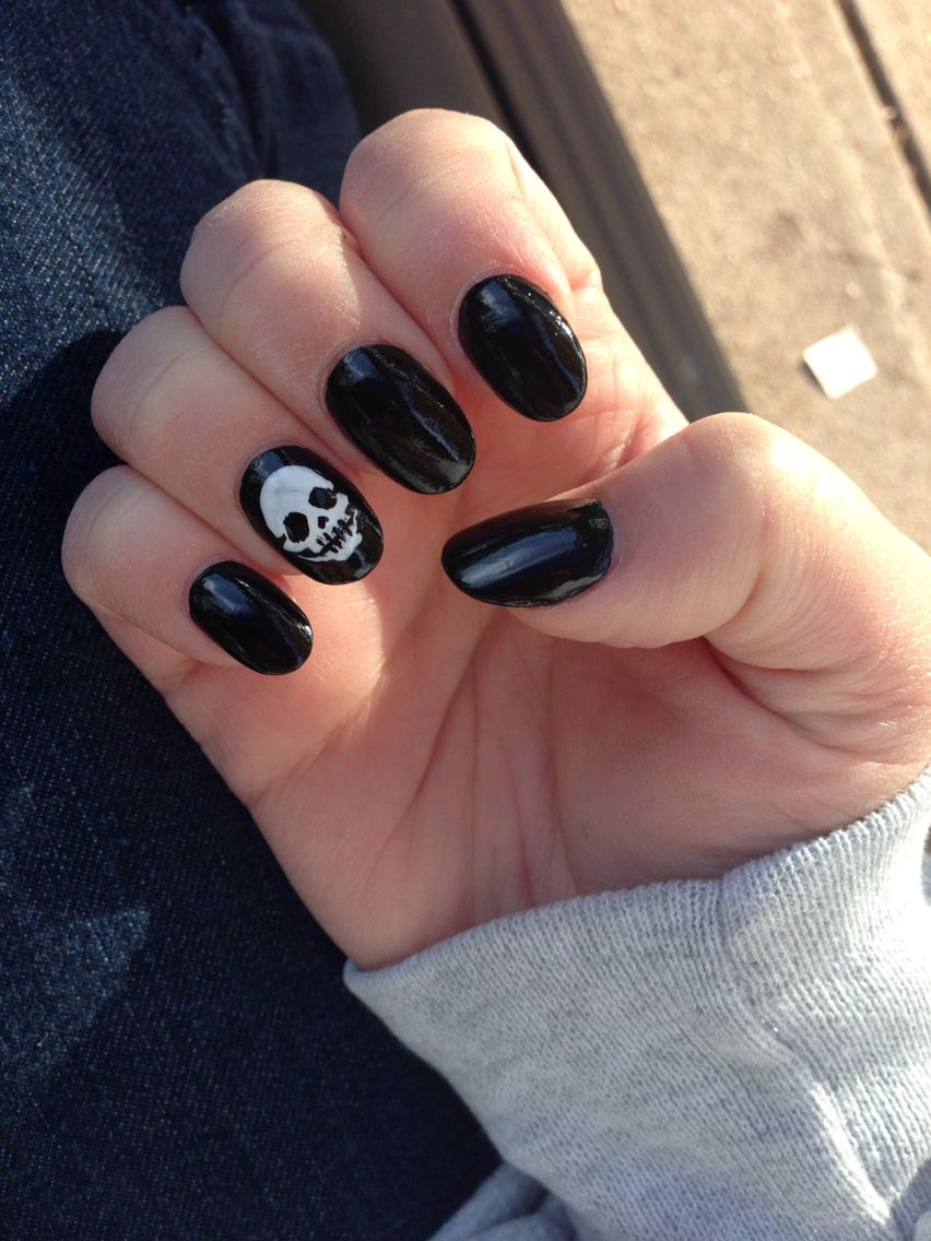 Oval black acrylic nails, skull design for Halloween ...