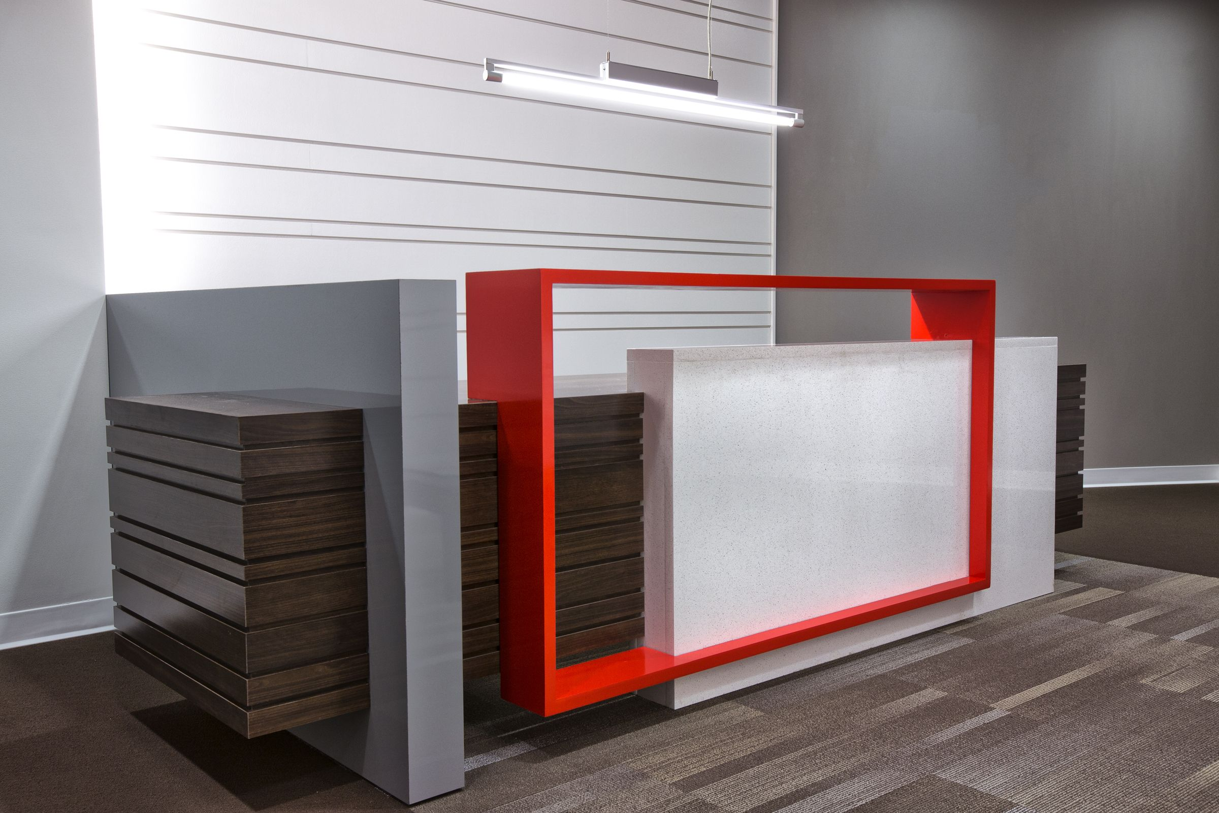 Custom designed reception desk with a welded metal accent for Custom office design