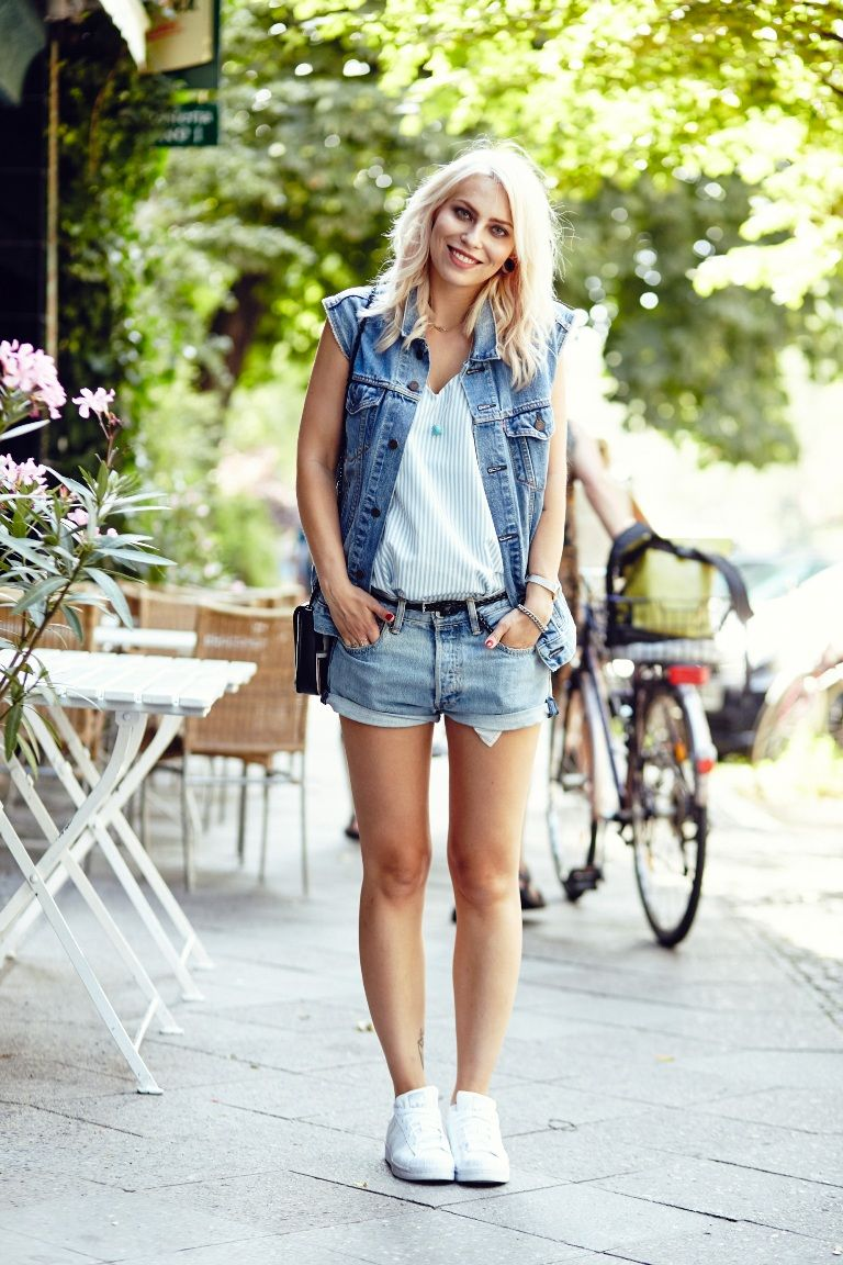 denim vest with shorts and sneakers