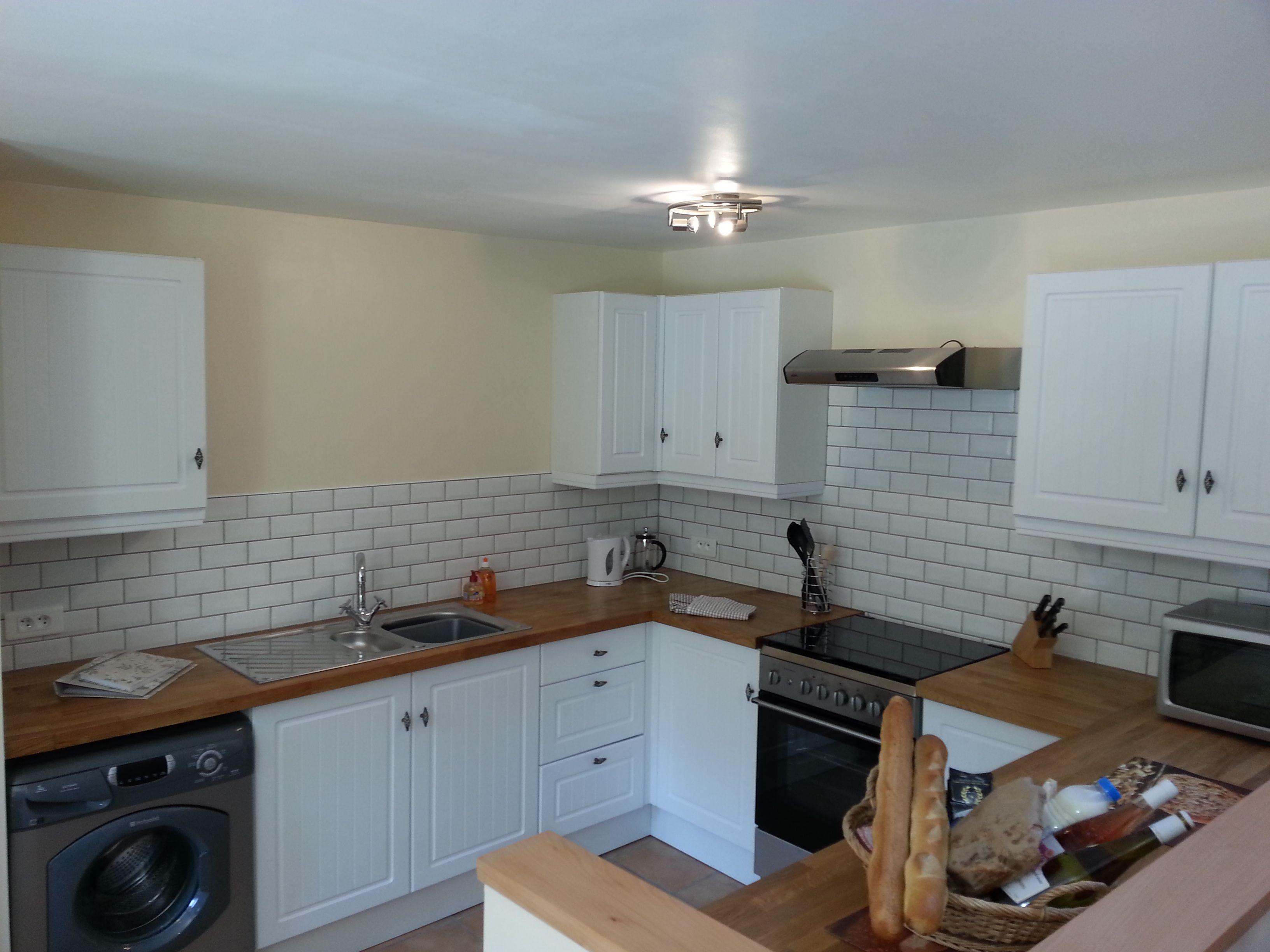 B&Q white kitchen with metro tiles and oak worktops