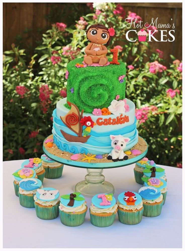 Moana Themed 1st Birthday Cake With Matching Cupcakes And A Sculpted Baby Topper