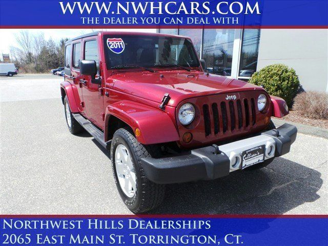 2011 Jeep Wrangler Unlimited, 56,297 miles, $27,000.