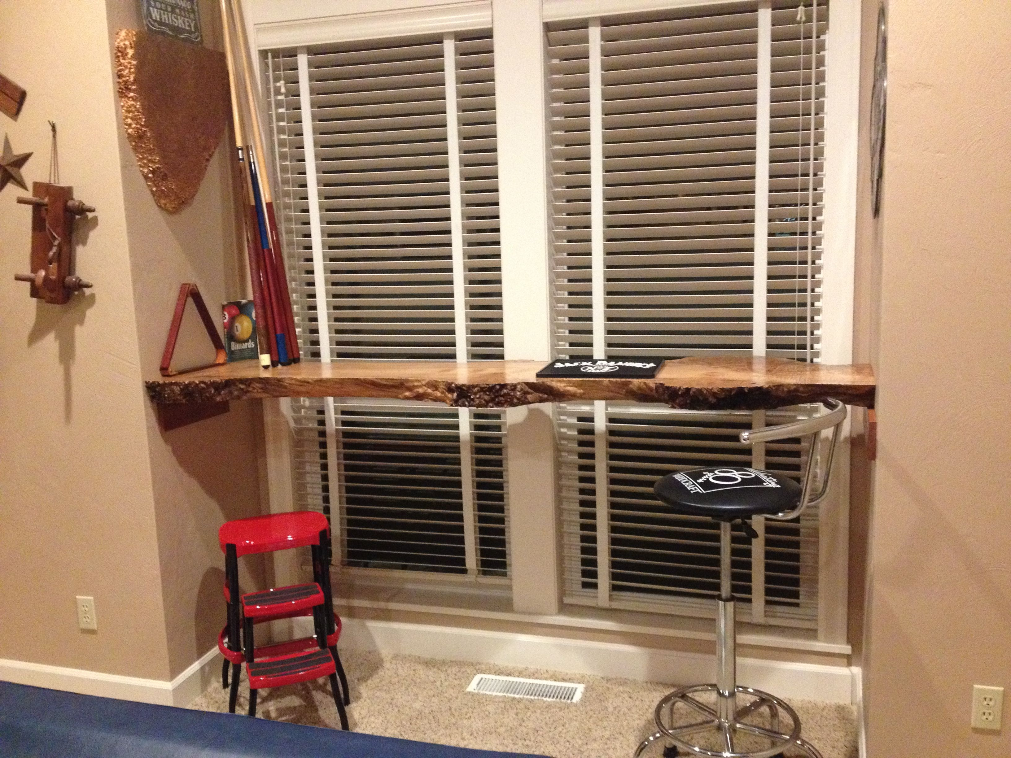 Live edge wood bar in our pool room. Used transtint to pop the grain and rubbed out with Waterlox.