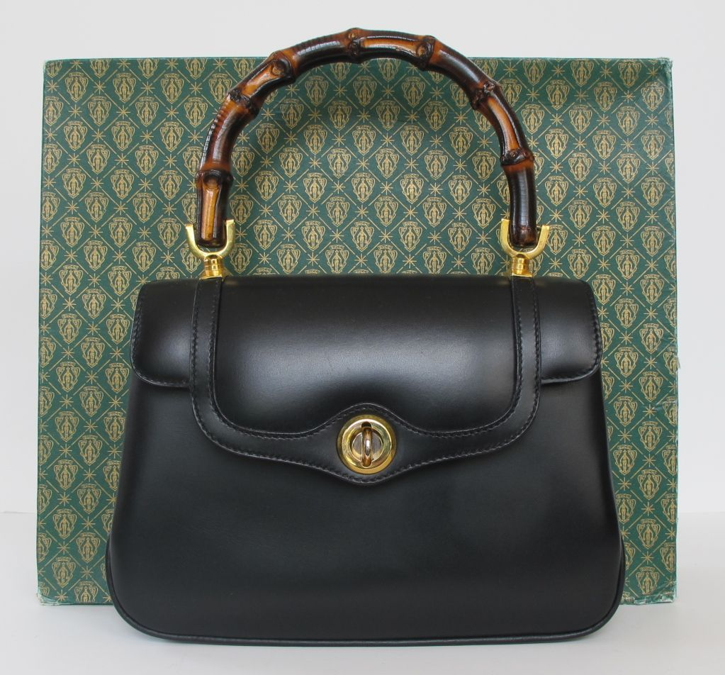 fb83d1a7b67d 1970's New Gucci Black Leather Handbag | From a collection of rare vintage  handbags and purses at www.1stdibs.com/... #guccivintagehandbags1970