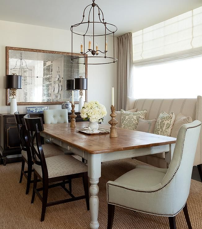 Beautiful dining room features an iron cage chandelier for Dining room farm table