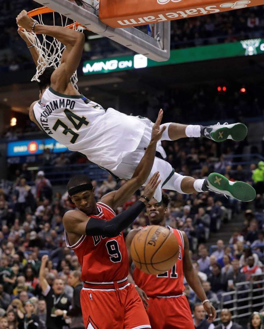 Milwaukee Bucks' Giannis Antetokounmpo dunks over Chicago