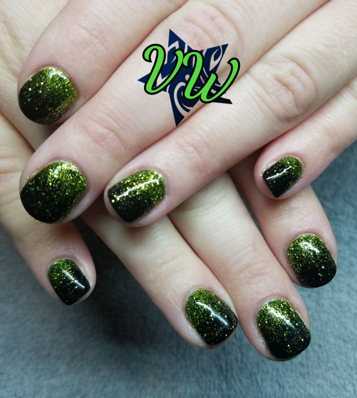 Black gel polish manicure with lime green glitter