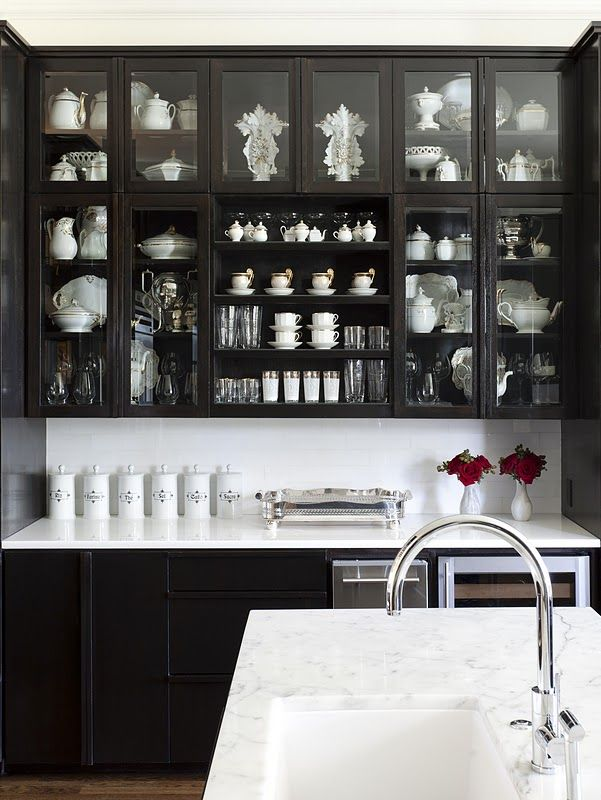 At Home Arkansas Kitchen Black Cabinets Glass Doors Marble Counters Via Cococozy Black Kitchen Cabinets Dark Kitchen Cabinets Dark Kitchen