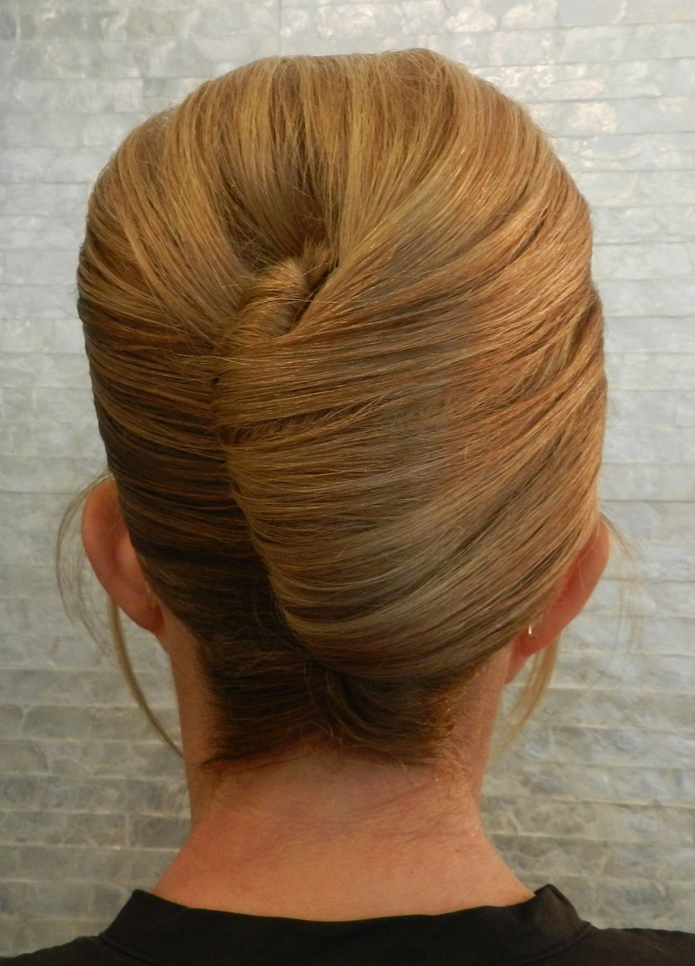 french twist updo with bangs. check